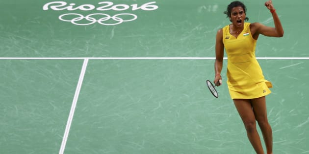 P.V. Sindhu (IND) of India celebrates winning the second set during her match against Wang Yihan (CHN) of China.