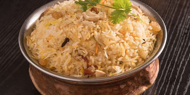 File photo of delicious biryani in a round brass bowl.