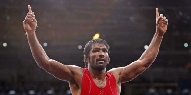 Yogeshwar Dutt celebrates his victory at the London Olympic Games in 2012.              REUTERS/Suhaib Salem