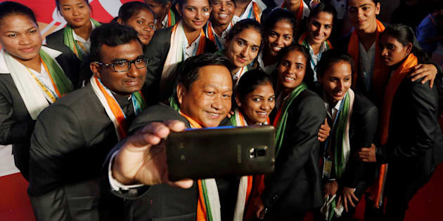 Indian women hockey team members, who will participate in the Rio 2016 Olympics, pose for a selfie during an introduction ceremony of the team, in New Delhi, India, July 12, 2016. REUTERS/Adnan Abidi