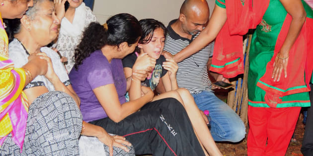 Family members and relatives of 55-year-old Gauri Lankesh, who was shot dead by unknown assailants in the porch of her home in Bangalore mourn her death overnight  on September 5, 2017.