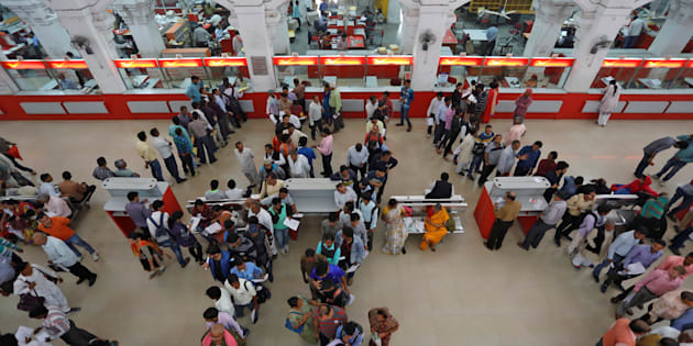 People wait in lines to deposit and withdraw money inside a post office in Lucknow, India, November 10, 2016.  REUTERS/Pawan Kumar