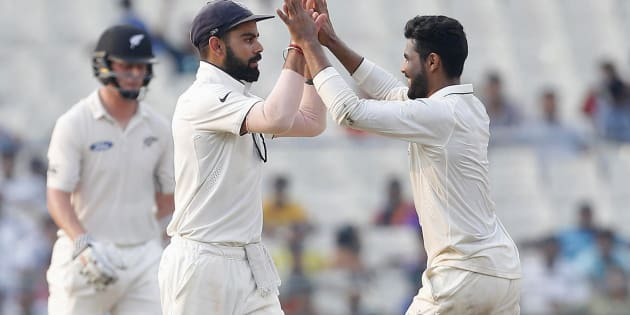 India's Ravindra Jadeja (R) celebrates with his captain Virat Kohli after taking the wicket of New Zealand's Matt Henry. REUTERS/Rupak De Chowdhuri