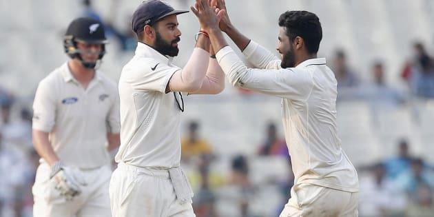 India's Ravindra Jadeja (R) celebrates with his captain Virat Kohli after taking the wicket of New Zealand's Matt Henry. REUTERS/Rupak De Chowdhuri