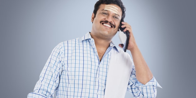 South Indian man talking on a mobile phone and smiling