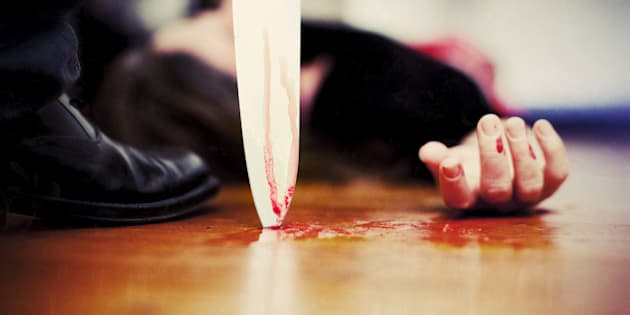 'Close up on a bloody knife planted on a wooden floor, a killing scene'
