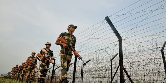 Indian Border Security Force (BSF) soldiers patrolling at the near Petrapole Border outpost at the India-Bangladesh Border on the outskirts of Kolkata,India.India arrested two citizens and said it was expelling a Pakistani high commission staffer for espionage activities on  27 October 2016  after busting a ring that collected documents on defence deployment and border area maps. (Photo by Debajyoti Chakraborty/NurPhoto via Getty Images)