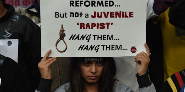 An Indian protester holds a placard during a demonstration against the release of a juvenile rapist in New Delhi.