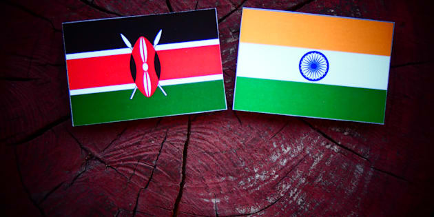 Kenyan flag with Indian flag on a tree stump.