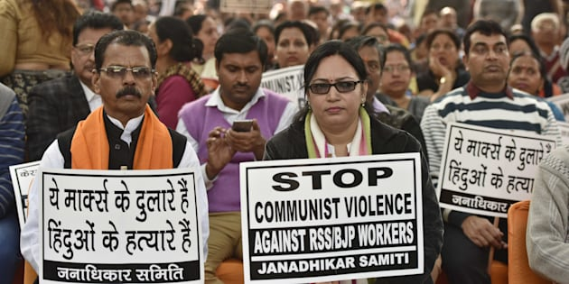 Supporters and workers holding placard during the protest against brutal attack on RSS-BJP workers in Kerala, at Kerala Bhavan on January 24, 2017 in New Delhi, India.