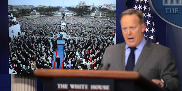 Press Secretary Sean Spicer delivers a statement while television screens show pictures of U.S. President Donald Trump's inauguration at the press briefing room of the White House in Washington U.S., January 21, 2017.  REUTERS/Carlos Barria