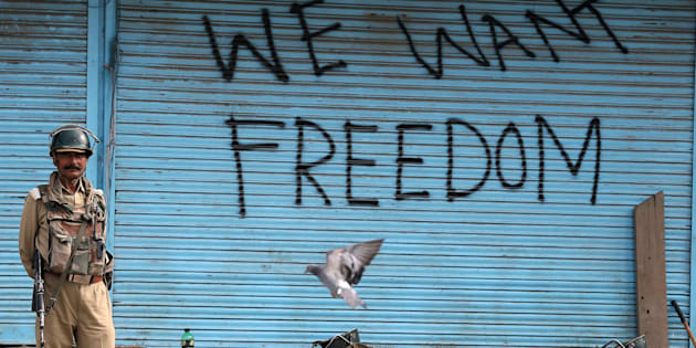 Graffiti is painted on shop shutters in Srinagar after an escalation of violence that officials have blamed on separatist protests that have tied down security forces for more than a month in Kashmir, August 17, 2016. REUTERS/Cathal McNaughton