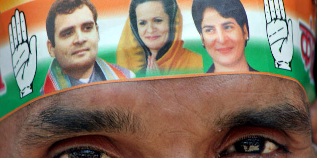 A Congress party worker wears a band on his forehead with pictures of party leaders Sonia Gandhi, Rahul Gandhi, and Priyanka Gandhi in Allahabad, India, Wednesday, April 11, 2007. (AP Photo/Rajesh Kumar Singh)