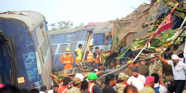 Rescue workers search for survivors in the wreckage of a train that derailed near Pukhrayan in Kanpur district on November 20, 2016. SANJAY KANOJIA/AFP/Getty Images