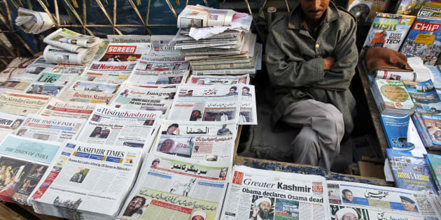 A newspaper vendor displays newspapers with cover stories of Osama bin Laden, in Srinagar, May 3, 2011. Bin Laden was killed in a U.S. special forces assault on a Pakistani compound, then quickly buried at sea, in a dramatic end to the long manhunt for the al Qaeda leader who had been the guiding star of global terrorism.   REUTERS/Danish Ismail (INDIAN-ADMINISTERED KASHMIR - Tags: POLITICS CIVIL UNREST OBITUARY SOCIETY)