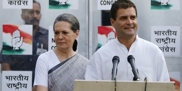 File photo of Congress party vice-president Rahul Gandhi with his mother and chief of Congress Sonia Gandhi (L).