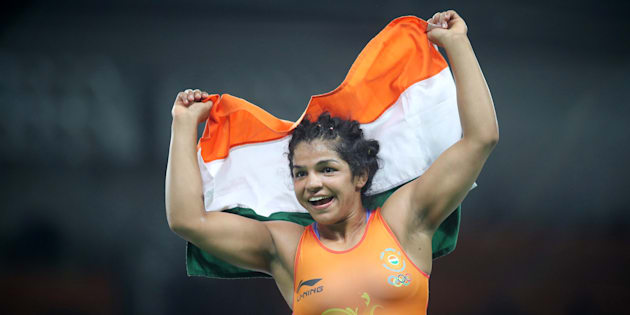 Sakshi Malik of India celebrates victory against  Aisuluu Tynybekova of Kyrgyzstan during their Women's Freestyle 58 kg Bronze Medal Final at the Rio Games on 17 August, 2016.