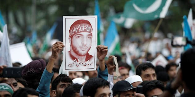 A picture of Hizbul Mujahideen commander Burhan Muzaffar Wani is held up during a rally condemning the violence in Kashmir, in Islamabad, Pakistan July 24, 2016. REUTERS/Caren Firouz