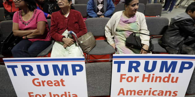 Signs placed on seats as people wait for a charity event hosted by the Republican Hindu Coalition.
