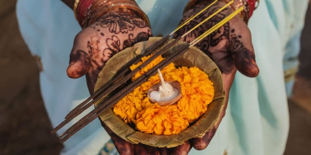 Decorated hands holding traditional offering, Allahabad, Uttar Pradesh, India