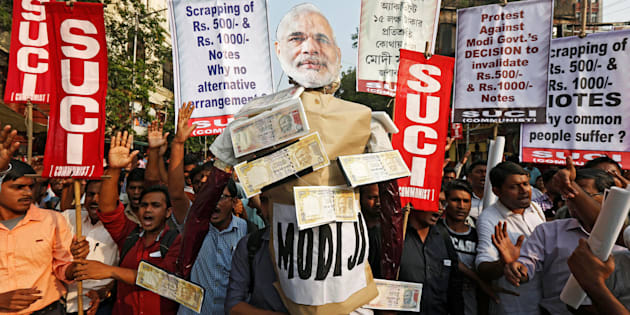 Activists of Socialist Unity Centre of India (SUCI) shout slogans as they carry an effigy of Prime Minister Narendra Modi during a protest against the government's decision to withdraw 500 and 1000 Indian rupee banknotes from circulation, according to a media release, in Kolkata, India, November 14, 2016. REUTERS/Rupak De Chowdhuri
