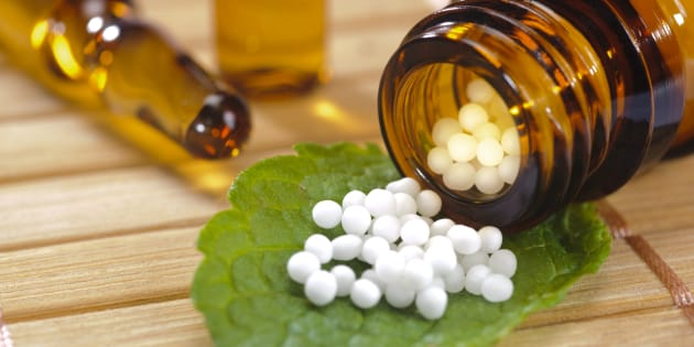 alternative medicine with homeopathy and herbal pills.