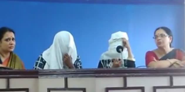 The gang rape survivor addresses a press conference along with her husband. Their faces have been covered to conceal their identity.