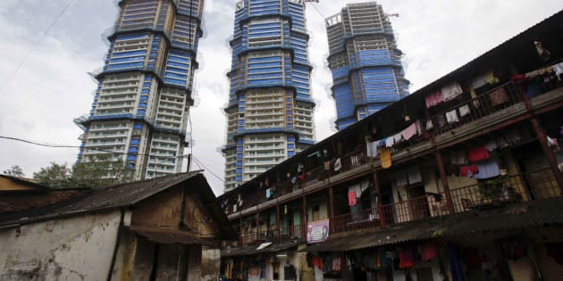 High-rise residential towers under construction are pictured behind an old residential building in central Mumbai.