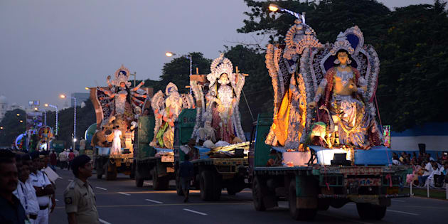 Spectators watching the immersion procession of  Hindu goddess Durga idol in Red road in Kolkata.
