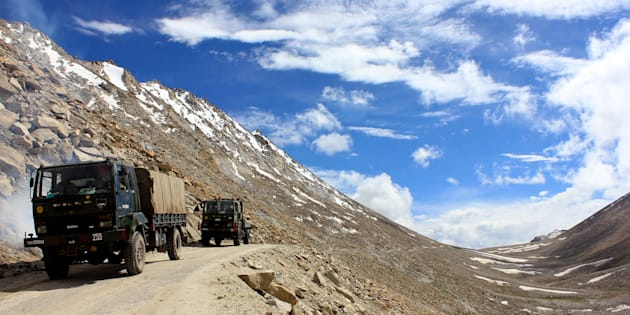 An Indian army convoy moves towards the border in Pangong, a disputed territory between India and China, on August 5, 2012 in Ladakh, Indian-administered Kashmir. (Photo by Yawar Nazir/Getty Images)