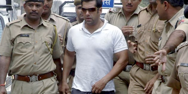 Bollywood actor Salman Khan is surrounded by police personnel on his way to the court in Jodhpur. REUTERS/Stringer