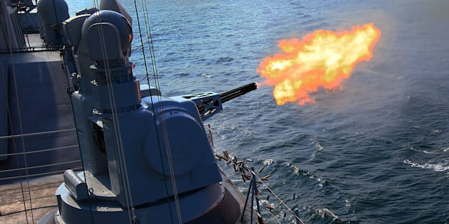 The Chinese frigate 'Guangzhou' fires secondary guns during a China-Russia naval joint drill at sea off south China's Guangdong Province, on Sept. 18, 2016.