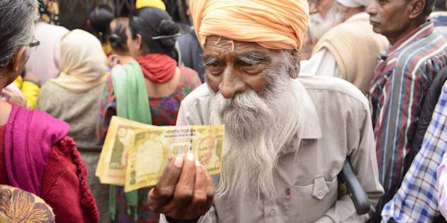 Senior citizens wait to deposit and exchange 500 and 1000 rupee notes in Amritsar, India. (Photo by Sameer Sehgal/Hindustan Times via Getty Images)
