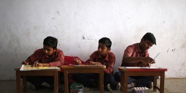 Boys attend a painting class at a school in Juhapura in Ahmedabad, March 1, 2014. REUTERS/Ahmad Masood