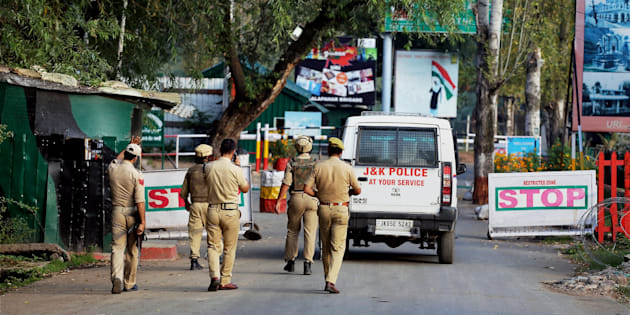 Uri: Special Operation Group of Jammu and Kashmir Police personnel move inside the Army Brigade camp during a terror attack in Uri, Jammu and Kashmir on Sunday. PTI Photo.