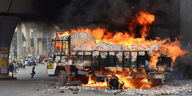 A truck from neighbouring Tamil Nadu burns after it was set alight by agitated pro-Karnataka activists in Bangalore on September 12, 2016.