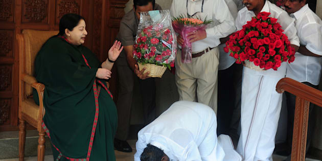 A party cadre prostrates himself at the feet of AIADMK leader Jayalalithaa in Chennai in May 2016. ARUN SANKAR/AFP/Getty Images.