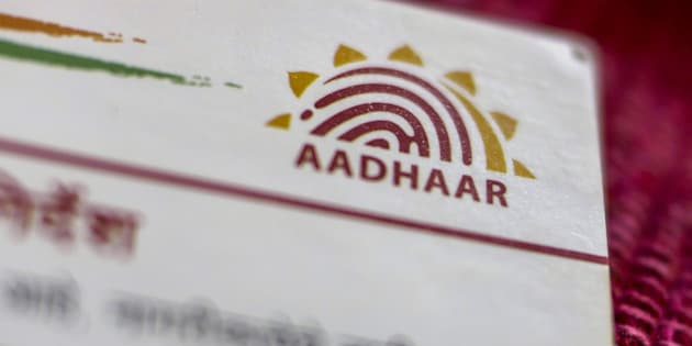 An Aadhaar biometric identity card, issued by the Unique Identification Authority of India (UIDAI), is arranged for a photograph in Mumbai, India, on Saturday, Jan. 28, 2017.