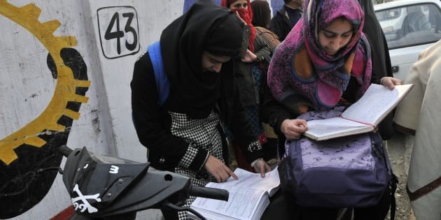 Students revise for the last time before entering exam centre as class 12 state board exams started in Kashmir amidst tight security.