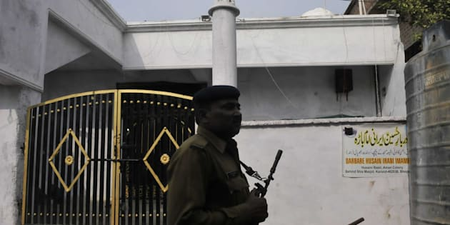 Police patrolling a deserted street of Aman colony at Karond area, on December 12, 2014 in Bhopal.