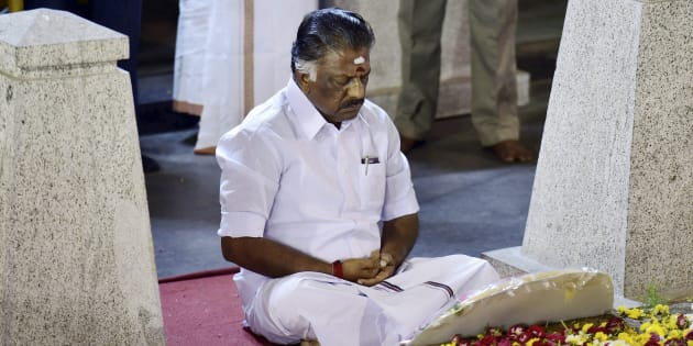 Tamil Nadu Chief Minister O Panneerselvam sitting in a meditation in front of late J Jayalalithaa's burial site at the Marina Beach in Chennai on Tuesday.