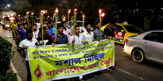Bangladesh Student Union arranged a torch procession to protest against the killing of bloggers, writers, teachers and editors in Dhaka on 26 April 2016. (Photo by Mohammad Ponir Hossain/NurPhoto via Getty Images)