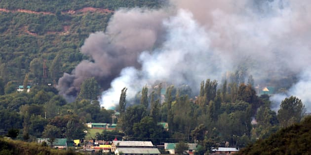 Smoke rises from the army base which was attacked by militants in the town of Uri, Kashmir on 18 September.