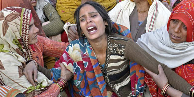 Grief: Dharamvati, pictured centre, the wife of an Indian soldier Hemraj Singh killed in combat.