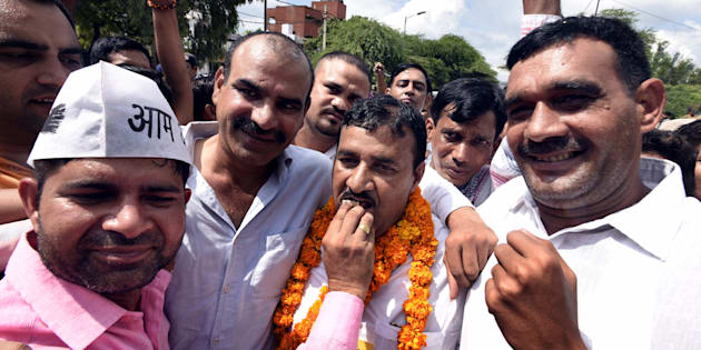 Ram Chandra, AAP candidate (center) along with his supporters after winning Bawana assembly by-poll, election at Ali Pur on August 28, 2017 in New Delhi, India.