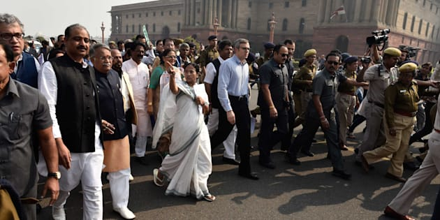 TMC leader and West Bengal Chief Minister Mamata Banerjee and former J&K CM Omar Abdullah lead a delegation of MPs from opposition parties in a protest march from Parliament to Rashtrapati Bhavan against demonetisation.