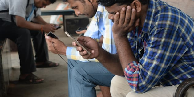 Indians surf the internet on their phones at a free wi-fi zone inside a suburban railway station in Mumbai.