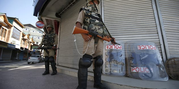 Indian Central Reserve Police Force (CRPF) personnel stand guard in front of closed shops during a strike in Srinagar June 17, 2015.