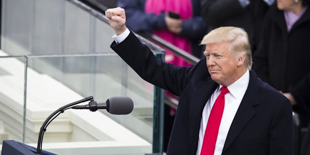 WASHINGTON, USA - JANUARY 20: President Donald Trump raises his fist to the crowds during the 58th U.S. Presidential Inauguration after he was sworn in as the 45th President of the United States of America in Washington, USA on January 20, 2017. (Photo by Samuel Corum/Anadolu Agency/Getty Images)