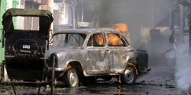 File photo of a car torched by protestors during a protest march in Kolkata, November 21, 2007.